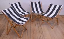 A SET OF FOUR BUTTERFLY CHAIRS