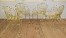 A SET OF FOUR VINTAGE WROUGHT IRON GARDEN CHAIRS