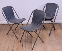 A SET OF FOUR SEBEL STACKING CHAIRS