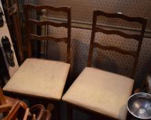 A PAIR OF RUSTIC LADDERBACK DINING CHAIRS