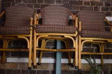 A SET OF SIX BAMBOO CHAIRS WITH UPHOLSTERED SEATS