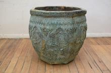 A IMPRESSIVE 19TH CENTURY CHINESE OCTAGONAL BRONZE WATER POT WITH SCENIC CARVED DECORATION (90cm h X 90cm w)