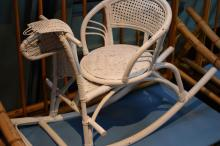 A WHITE PAINTED WICKER CHILDS ROCKING HORSE