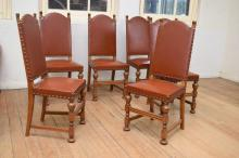 A SET OF SIX FRENCH TUDOR STYLE OAK HIGH BACK DINING CHAIRS