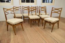 A SET OF 1960'S ZIERT DESIGNED BLACKBEAN LEATHER DINING CHAIRS