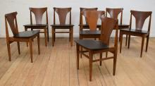 A SET OF EIGHT DANISH STYLE TEAK FRAMED DINING CHAIRS