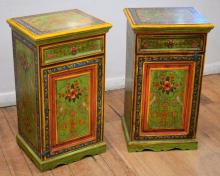 A PAIR OF CONTINENTAL PAINTED BEDSIDE CABINETS