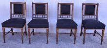 A SET OF FOUR EMPIRE STYLE DINING CHAIRS