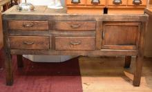 A RUSTIC TIMBER SIDE CABINET