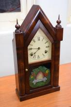 A LATE 19TH CENTURY AMERICAN EIGHT DAY STEEPLE CLOCK
