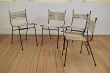 A SET OF FOUR MEADMORE STRING CHAIRS