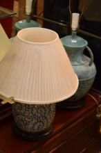 AN ORIENTAL AND A LIMED TABLE LAMP