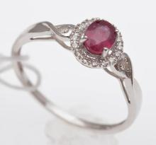 A TREATED RUBY AND DIAMOND RING, STAMPED STERLING SILVER