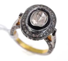 A TABLE CUT DIAMOND CLUSTER RING OF APPROXIMATELY 1.50CTS, IN SILVER GILT