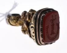 A VICTORIAN CARVED CARNELIAN SEAL