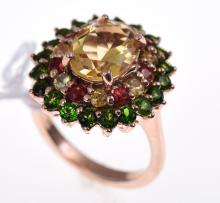 A CITRINE AND DIOPSIDE SET DRESS RING IN SILVER GILT