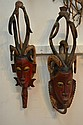 A PAIR OF RED AFRICAN WOOD CARVED TRIBAL MASKS