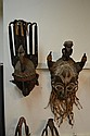 TWO LARGE AFRICAN WOOD CARVED TRIBAL MASKS