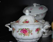 A PART SHELF OF TUREENS AND GRAVY BOAT