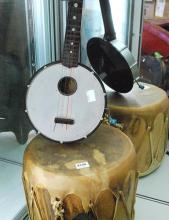 A SKIN DRUM PURCHASED FROM AN INDIAN RESERVATION IN TEXAS AND A CHILDS SEIKO INSTRUMENT