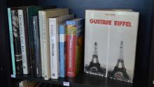 A SHELF OF BOOKS ON ARCHITECTURE AND DESIGN, INCL. DECORATIVE CAST IRON