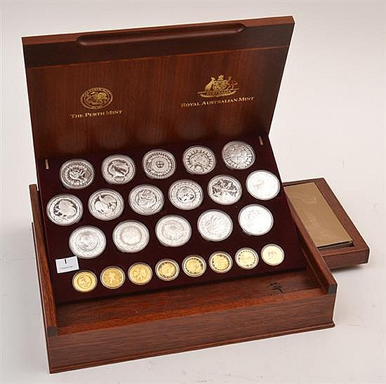 A BOXED SET EIGHT SYDNEY 2000 OLYMPIC COINS EIGHT IN PURE GOLD AND SIXTEEN SILVER COINS IN PRESENTATION BOX
