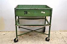 AN INDUSTRIAL BOOK TROLLEY IN TEAL (MISSING CASTOR)