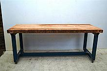 A BLUE INDUSTRIAL METAL STRETCHER BASE TABLE WITH CANADIAN OREGON PLANK TOP AND CASTORS