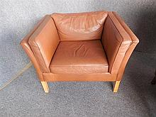 MOGENS HANSEN (DANISH, BORN 1940) BROWN LEATHER ARMCHAIR