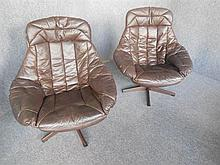 PAIR OF H.W. KLEIN (NORWEGIAN, BORN 1919) BROWN LEATHER ARMCHAIRS ON SWIVEL BASES