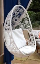 A 1960S STYLE WHITE LATTICED EGG SEAT