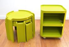 A LIME GREEN KARTELL CABINET ON CASTORS, AND A LIME GREEN NEST OF THREE OCCASIONAL TABLES (CRACKS TO ONE)
