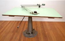 A SWEDISH MADE VINTAGE DRAFTING TABLE WITH HYDROLIC BASE (TOP UNATTACHED WITH MISSING PLANK)