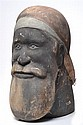 * DONALD GREY (20TH CENTURY) Untitled (Head of Ancestral Figure) natural earth pigments on carved sandstone