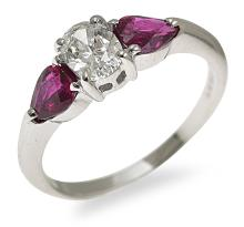 A THREE STONE RUBY AND DIAMOND RING