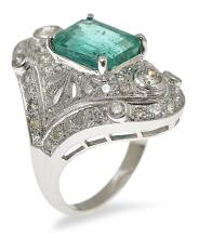 AN ART DECO STYLE EMERALD AND DIAMOND RING