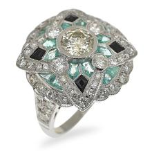 AN ART DECO STYLE DIAMOND, EMERALD AND ONYX RING