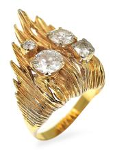 A DIAMOND AND GOLD COCKTAIL RING