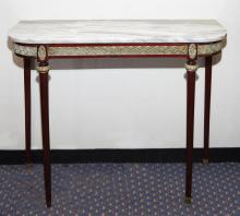 A LOUIS XVI STYLE CARRERA MARBLE TOPPED CONSOLE TABLE