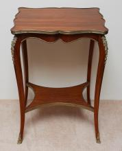 A FRENCH LOUIS XV STYLE GILT METAL MOUNTED ROSEWOOD GUERIDON