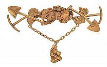 AN ANTIQUE GOLD MINERS BROOCH