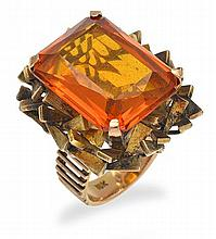 A GOLDEN TOPAZ COCKTAIL RING