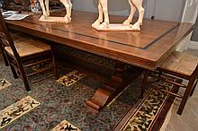 A DECOLLO REFECTORY TABLE WITH EBONISED BORDER ON TWIN PEDESTALS