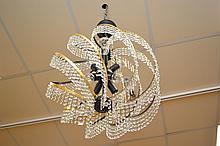 AN EIGHT GLOBE SWAROVSKI CRYSTAL GOLD AND BLACK SPIRAL CHANDELIER (CORD AND PLUG NOT INCLUDED)