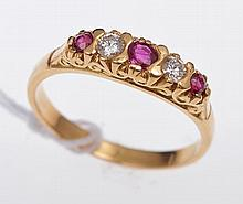 A RUBY AND DIAMOND HALF HOOP STYLE RING, IN 18CT GOLD