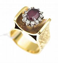 A RETRO RUBY AND DIAMOND CLUSTER RING IN 18CT GOLD