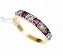 A RUBY AND DIAMOND RING IN 18CT GOLD