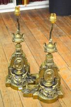 A PAIR OF CAST BRONZE AND GILT ELECTRIFIED LAMPS