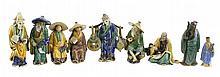 9 Pc. Glazed Chinese Mud Man Lot