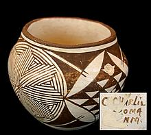 C. Charlie Native American Acoma Pottery Jar